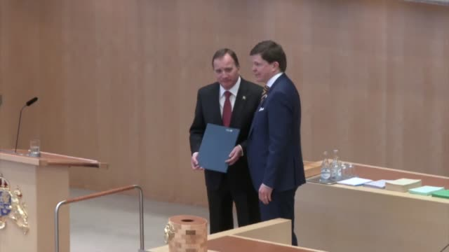 Stefan Lofven leader of the centerleft Social Democrats receives the prime minister's mandate from Parliament Speaker Andreas Norlen after being...