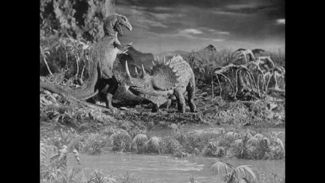 1925 stegosaurus is attacked by vengeful t-rex next to corpse of other t-rex - 1925 stock videos & royalty-free footage