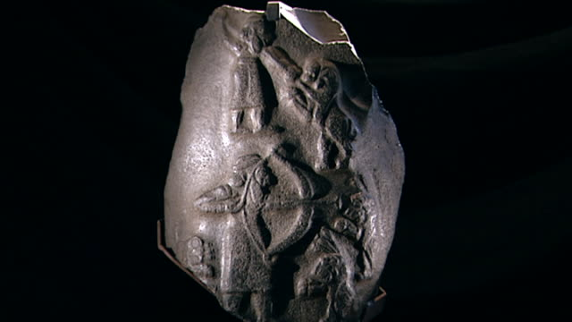 stele with priest-king's lion hunt. black diorite, c. 3000 bce. fragment of a stele depicting a priest-king hunting a lion in two scenes. mcu. - column stock videos & royalty-free footage