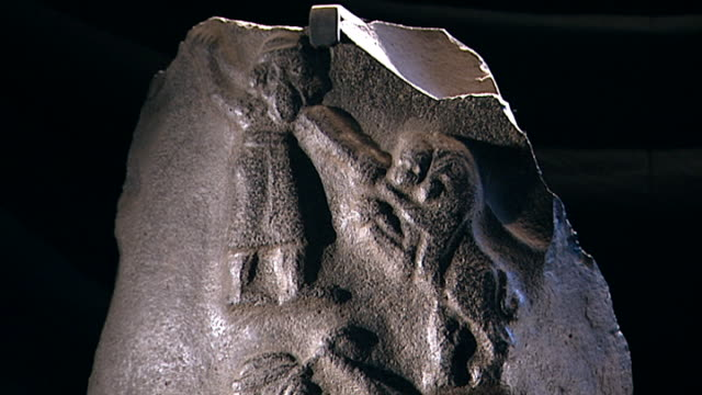 stele with priest-king's lion hunt. black diorite, c. 3000 bce. fragment of a stele depicting a priest-king hunting a lion in two scenes. king... - column stock videos & royalty-free footage