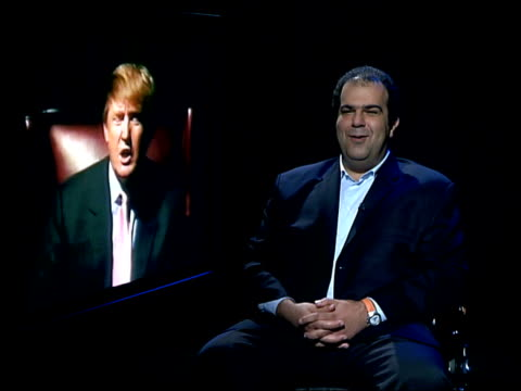 show 'the apprentice' int stelios hajiioannou interviewed sot we'll have to discuss how it will be adapted for this audience because i'm not donald... - reality tv stock videos & royalty-free footage