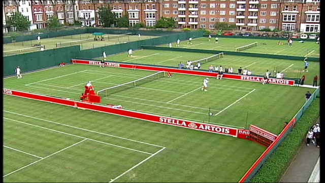 Greg Rusedski interview ITN ENGLAND London Queen's Club EXT Tennis players practicing on courts PAN Stella Artois grass court championships flag in...