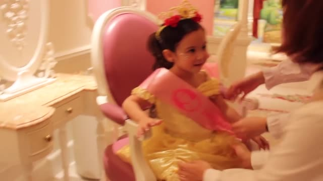 stella is transformed into one of her favorite princesses - belle at the bibbidi bobbidi boutique at hong kong disneyland. check it out! - princess stock videos & royalty-free footage