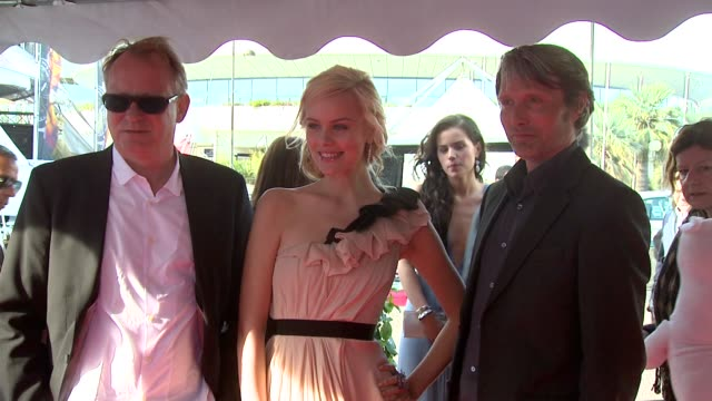 stellan skarsg_rd, helena mattsson, mads mikkelsen at the moomins and the comet chase launch: cannes film festival 2010 at cannes . - 彗星点の映像素材/bロール