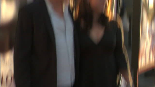 stellan skarsgard girlfriend megan everett walking down red carpet together outside the cinerama dome - シネラマドーム点の映像素材/bロール