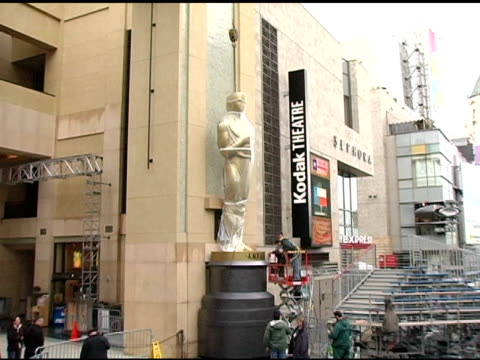 tighten the bolts that hold the oscar on at the 2005 annual academy awards arrivals area setup at the kodak theatre in hollywood california on... - tighten stock videos and b-roll footage