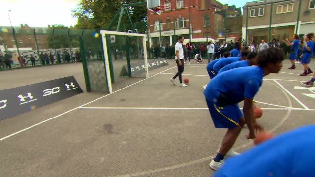 steph curry coaching young children in east london - basketball sport stock videos & royalty-free footage