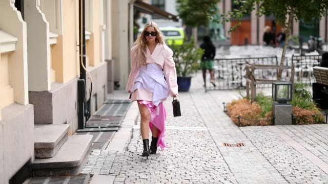 Stephanie Broek wearing asymmetrical pink skirt black mini bag Gucci ankle boots pink top is seen outside Cathrine Hammel during Oslo Runway SS19 on...