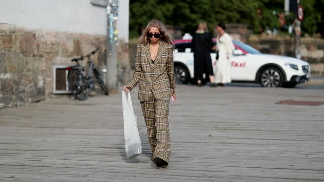 Stephanie Broek wearing beige brown checked suit seen outside byTiMo during Oslo Runway SS19 on August 14 2018 in Oslo Norway