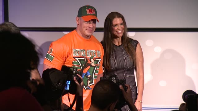 stephanie mcmahon and john cena at dave buster's time square on august 21 2015 in new york city - cena stock videos & royalty-free footage