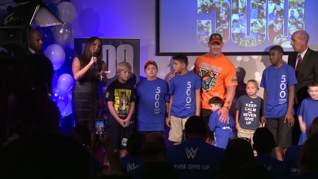 speech stephanie mcmahon presents david williams and the makeawish foundation with a check for one million dollars from wwe at dave buster's time... - cena stock videos & royalty-free footage