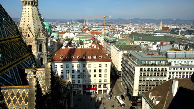 stephansdom with skyline vienna, panning - vienna austria stock videos & royalty-free footage