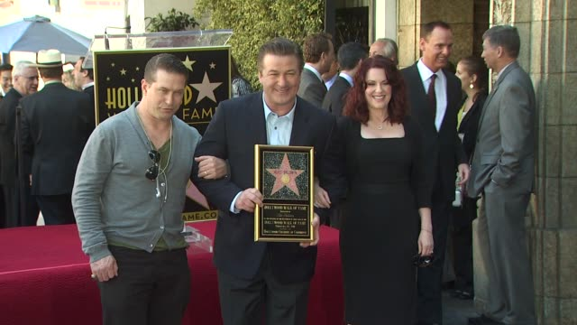 stephen baldwin alec baldwin and megan mullally at the alec baldwin honored with a star on the hollywood walk of fame at hollywood ca - alec baldwin stock videos & royalty-free footage