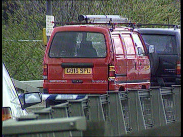 stephen cameron murder: kenneth noye trial; lib kent: scene of murder on m25 slip road taped off by police zoom in vehicle of victim at scene of... - kenneth noye stock videos & royalty-free footage