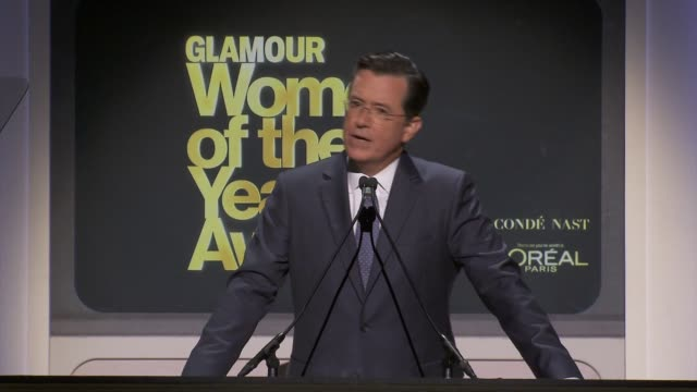 speech stephen colbert sniffs the magazine and says that is a cheap high jokes about him being a gq man of the year introduces mindy kaling who... - for him magazine点の映像素材/bロール