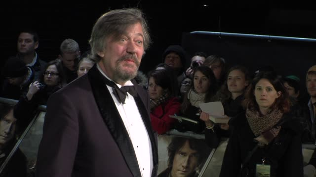 stephen fry at 'the hobbit' uk premiere and royal film performance at odeon leicester square on december 12, 2012 in london, england. - stephen fry stock videos & royalty-free footage