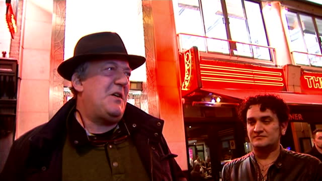 stephen fry calls for soho to be protected from gentrification england london soho images** neon sign on building 'raymond revuebar' people along... - amplifier stock-videos und b-roll-filmmaterial