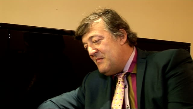 stephen fry interview on his new autobiography fry interview continues sot on what his wedding present would be for prince william and kate middleton... - スティーブン フライ点の映像素材/bロール