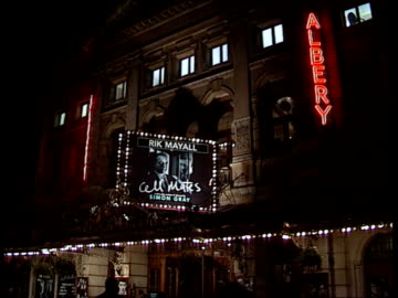 message confirms that the actor is 'live and well'; itn england: london: albery threate night stephen fry 's face on poster outside theatre... - rik mayall stock videos & royalty-free footage