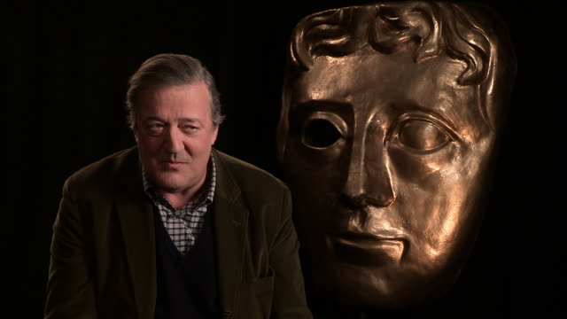 stephen fry on being at bafta for ten years, splitting of tv and film awards, changing the date to before the oscars atbafta interview at upbeat on... - stephen fry stock videos & royalty-free footage