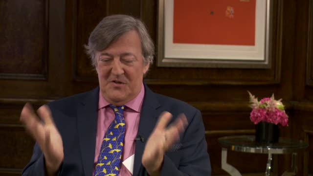 vídeos de stock e filmes b-roll de stephen fry saying that whilst he doesn't believe in a religious god, he can appreciate the art and history associated with it - stephen fry