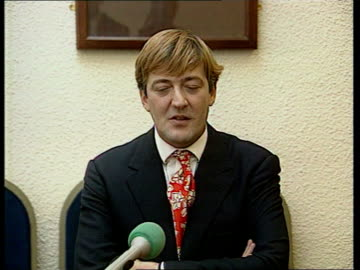 stephen fry speaks out; itn scotland dundee university stephen fry sits in front of dundee university plaque with his name on tcms female journalist... - rik mayall stock videos & royalty-free footage