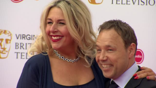 stephen graham and wife pose for photos on red carpet at bafta tv awards 2019 at royal festival hall london - two people stock videos & royalty-free footage