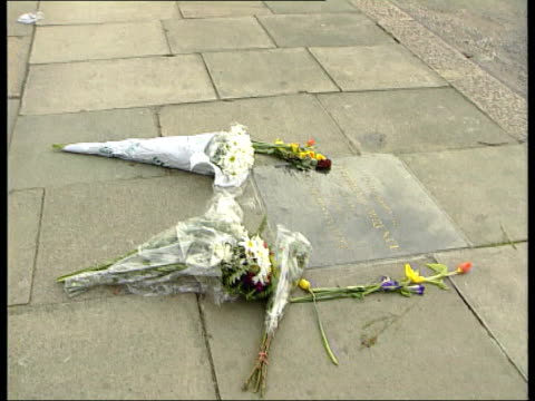 Double Jeopardy rule to be scrapped LIB Eltham Street where Stephen Lawrence was murdered TILT DOWN memorial plaque with flowers laid on ground LIB...