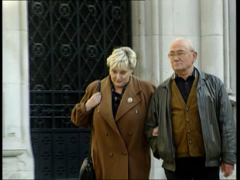 Double Jeopardy rule to be scrapped London Ann and Charlie Ming along street PULL OUT