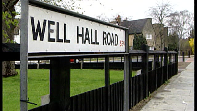 20th anniversary memorial service t18051115 / tx eltham 'well hall road' street sign flowers on pavement - murder stock videos & royalty-free footage
