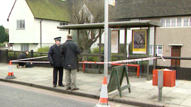 gary dobson and david norris to face trial 2341993 south london eltham ext police at cordonned off bus stop where stephen was fatally stabbed plaque... - murder stock videos & royalty-free footage