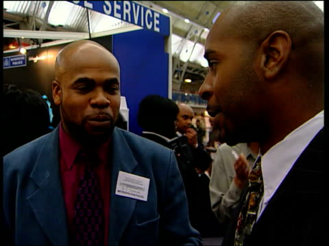 leaked report row itn people on metropolitan police stand at graduate recruitment fair talking to people interested in joining the force cs programme... - sleeve stock videos & royalty-free footage
