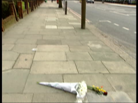 stephen lawrence murder inquiry report made public itn ext gv street where stephen lawrence was killed tilt down to memorial paving stone plaque with... - paving stone stock videos and b-roll footage