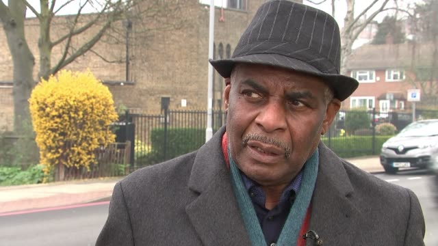 Neville Lawrence interview as 25th anniversary approaches Eltham EXT Neville Lawrence cleaning memorial ZOOM IN Close shot memorial on pavement...