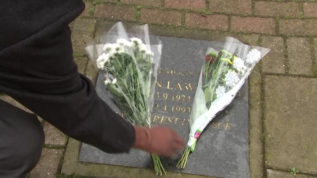 Neville Lawrence interview as 25th anniversary approaches Neville Lawrence laying bouquet of flowers on memorial Lawrence looking down