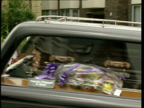 No further charges LIB ENGLAND Eltham GV hearse along carrying the coffin of Stephen Lawrence with people holding banner of Stephen following PAN TGV...