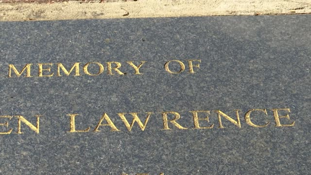 police investigation classified as inactive england london eltham well hall road close shot memorial plaque for stephen lawrence - crime and murder stock videos & royalty-free footage