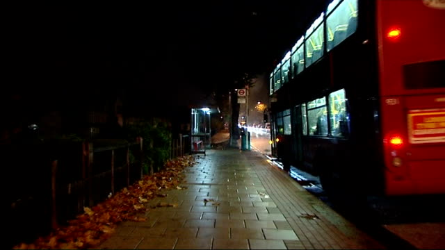 stephen lawrence murder trial: day 1; england: london: eltham: well hall road: ext / night bus stop where stephen lawrence was stabbed to death in... - 1日目点の映像素材/bロール
