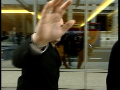 family demand debt law changes itn hand covering lens as royal bank of scotland worker pushing camera back demanding to know who has authorised... - covering stock videos and b-roll footage