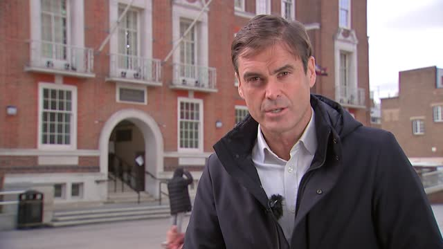 dog walker describes finding bodies of victims; england: london: barking town hall: ext reporter piece to camera sot - itv london tonight stock videos & royalty-free footage
