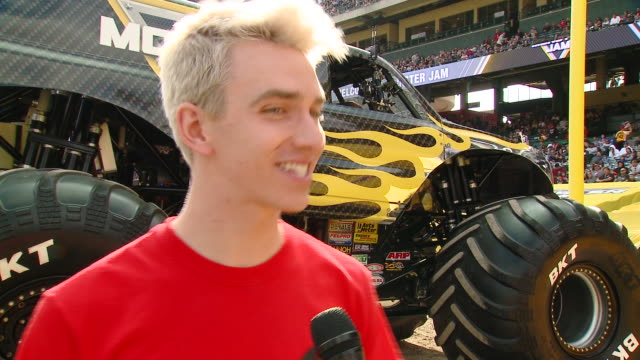 stephen sharer on tell us who are you here with today and what are you looking forward to seeing at monster jam, on which truck is your favorite and... - angel stadium stock videos & royalty-free footage