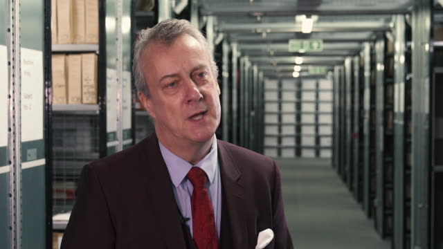 vídeos de stock e filmes b-roll de interview stephen tompkinson on how storytelling made charles dickens was a great performer stephen tompkinson interviews at getty image archive on... - charles dickens