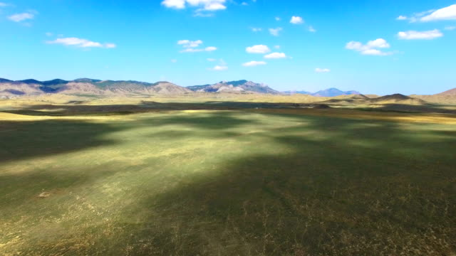 AERIAL: Steppe and hills on blue sky background