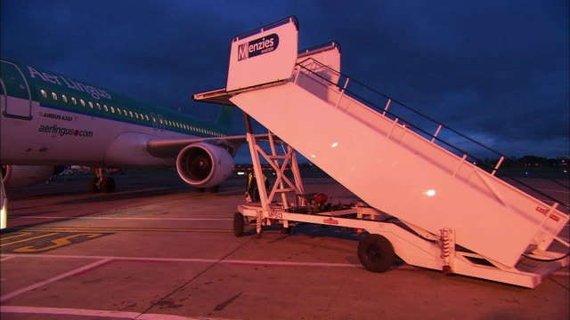 steps are driven away from aeroplane prior to departure, northern ireland - グランドキーパー点の映像素材/bロール