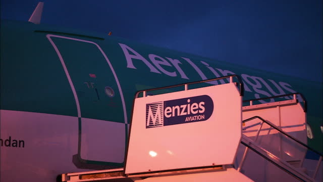 Steps are pulled away from door of Aer Lingus aeroplane, Northern Ireland