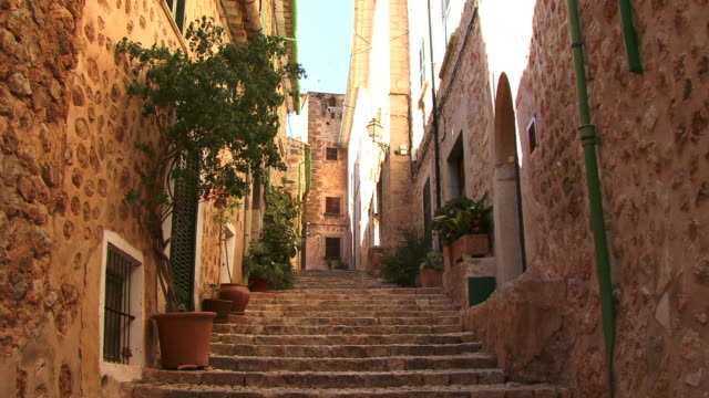 ms, la, steps between buildings in old town, spain, balearic islands, mallorca, fornalutx - old town stock videos & royalty-free footage