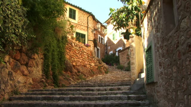 ms, steps between buildings in old town, spain, balearic islands, mallorca, fornalutx - old town stock videos & royalty-free footage