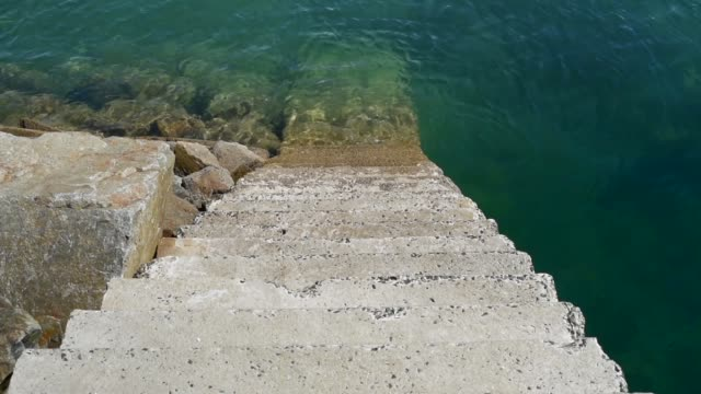 steps into the sea, harbour at pen ar roz. - david johnson stock videos & royalty-free footage