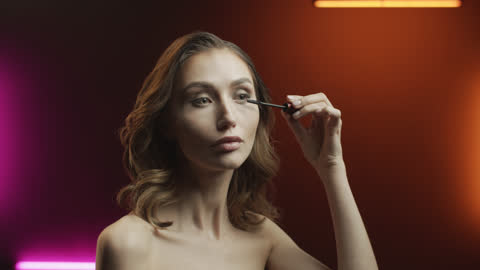 steps of make-up applying. young woman paints eyelashes with mascara with a make-up brush. - eyelash stock videos & royalty-free footage