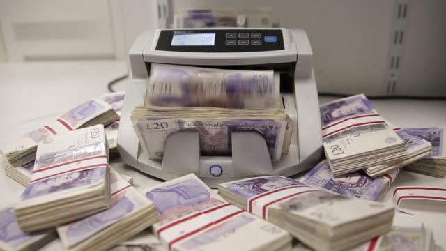 sterling 20 pound banknotes pass through an automated currency counting machine in this arranged photograph inside a travelex store, operated by... - banknote stock videos & royalty-free footage